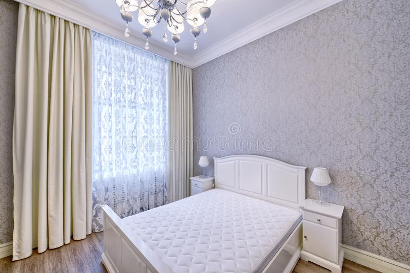 Interior design beautiful bedroom in luxury home. Russia, Moscow - modern designer renovation in a luxury building. Stylish bedroom interior with double bed stock photos