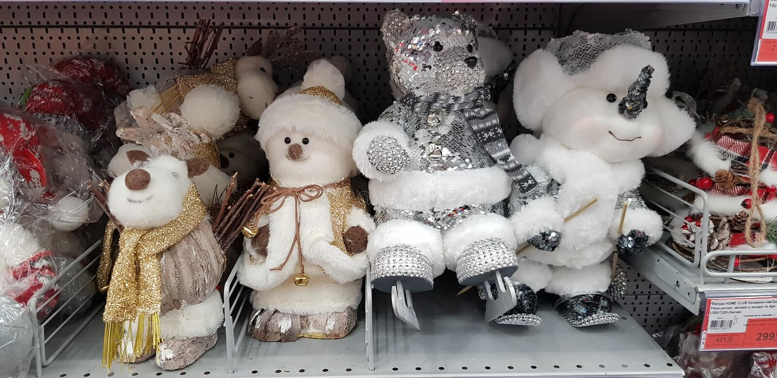 New Year`s toys on the supermarket shelf - snowmen, deer, bears. Russia Moscow. 10,11,2018 New Year`s toys on the supermarket shelf - snowmen, deer, bears stock photo