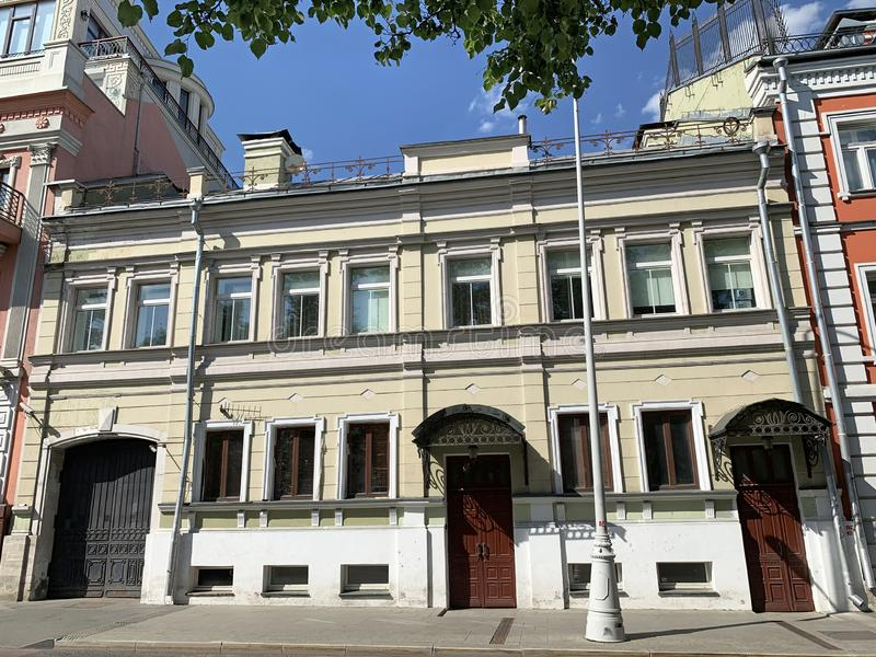 Russia, Moscow, Petrovsky Boulevard, complex of historic buildings - house 23 in sunny summer day.  stock photo