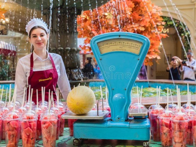 06.09.2019 Russia, Moscow, Red Square. Melon counter. Watermelons and melons are cut into pieces and packed in individual royalty free stock images