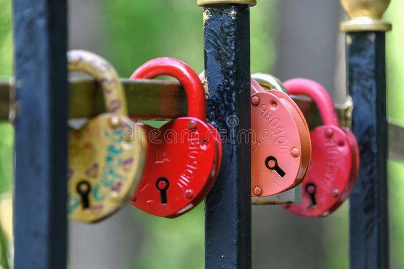 Russia, Moscow region, Ramenskoye May 10, 2019. Closed locks on the fence of the bridge. royalty free stock photo