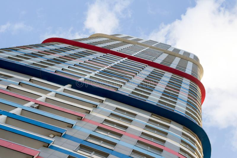 """Russia, Moscow, high-rise residential building, skyscraper. Russia, Moscow, 01.06.2019:  Residential skyscraper """"Tricolor"""" in the northeast of the city royalty free stock images"""