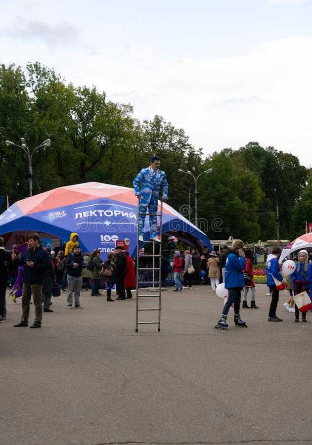Russia, Moscow, 21 September 2019, Moscow Ambulance 100th Anniversary Festival, Sokolniki park. Acrobat on the stairs entertains t stock photo
