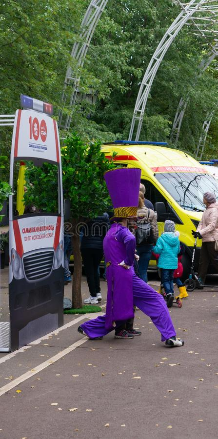 Russia, Moscow, 21 September 2019, Moscow Ambulance 100th Anniversary Festival, Sokolniki park. Clown in funny costume entertains royalty free stock photo