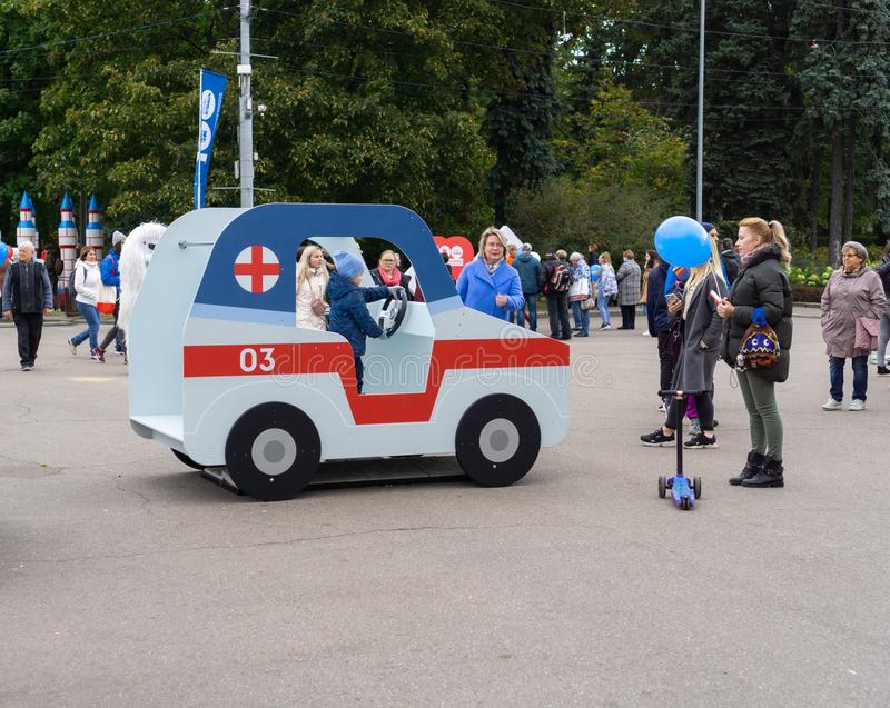 Russia, Moscow, 21 September 2019, Moscow Ambulance 100th Anniversary Festival, Sokolniki park. Kid playing inside schematic model royalty free stock photos