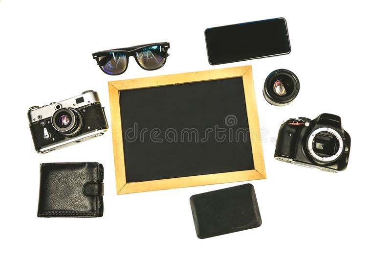 Russia Moscow 10 september 2019. set of tourist photographer on white background. Russia Moscow 10 september 2019. Composition with equipment for professional royalty free stock photos