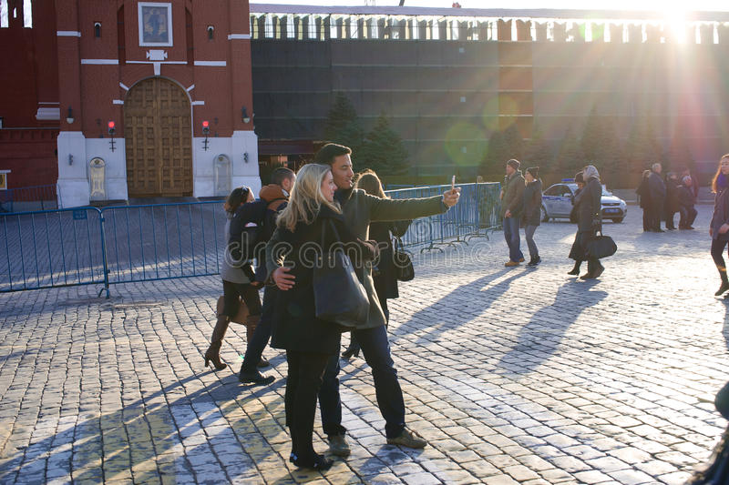 03/26/2016 Russia, Moscow. A series of. Walking in Moscow. Moscow and faces. Red Square. Tourists make selfie in front of St. Basil's Cathedral stock photo