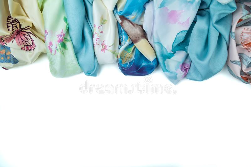 11.01.2019 Russia, Moscow. A set of multi-colored patterned fabrics on the white isolated background. Copyspace frame stock images