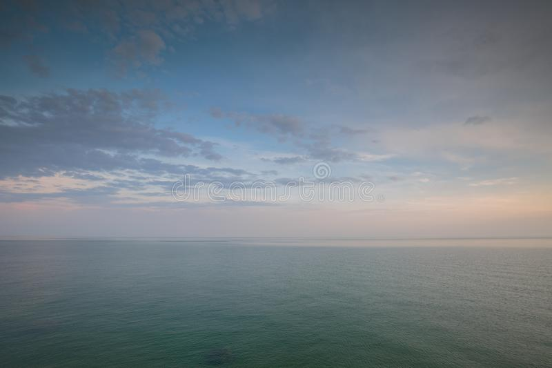 The movement of clouds in the spring in the steppe part of the C. Russia. The movement of clouds in the spring in the steppe part of the Crimea peninsula at Cape royalty free stock image