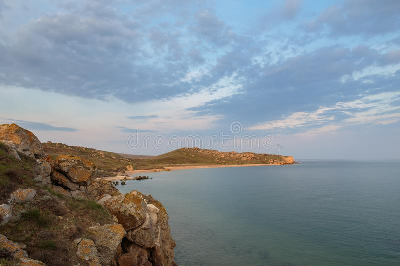 The movement of clouds in the spring in the steppe part of the C. Russia. The movement of clouds in the spring in the steppe part of the Crimea peninsula at Cape royalty free stock photography