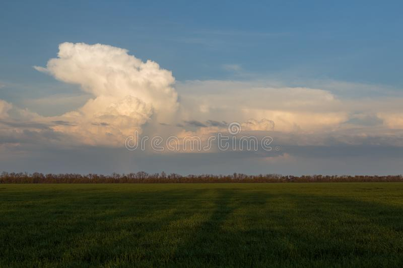 The movement of clouds in the spring in the steppe part of the C. Russia. The movement of clouds in the spring in the steppe part of the Crimea peninsula at Cape stock images
