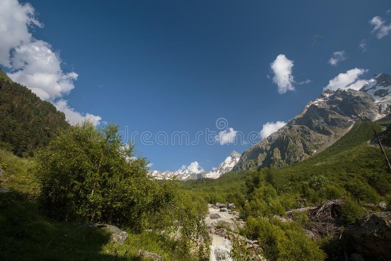 Movement of clouds and water flows in a stormy river in the Caucasus mountains in summer. Russia. Movement of clouds and water flows in a stormy river in the royalty free stock photo