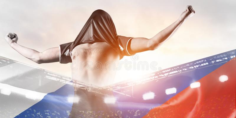 Russia player celebrating goal. Russia national team. Double exposure photo of stadium and soccer or football player celebrating goal with his jersey on head stock photo