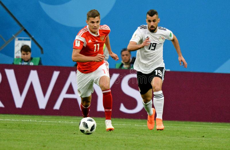 Russia national team midfielder Roman Zobnin with Egypt national team attacking midfielder Abdallah Said. St Petersburg, Russia - June 19, 2018. Russia national stock photo