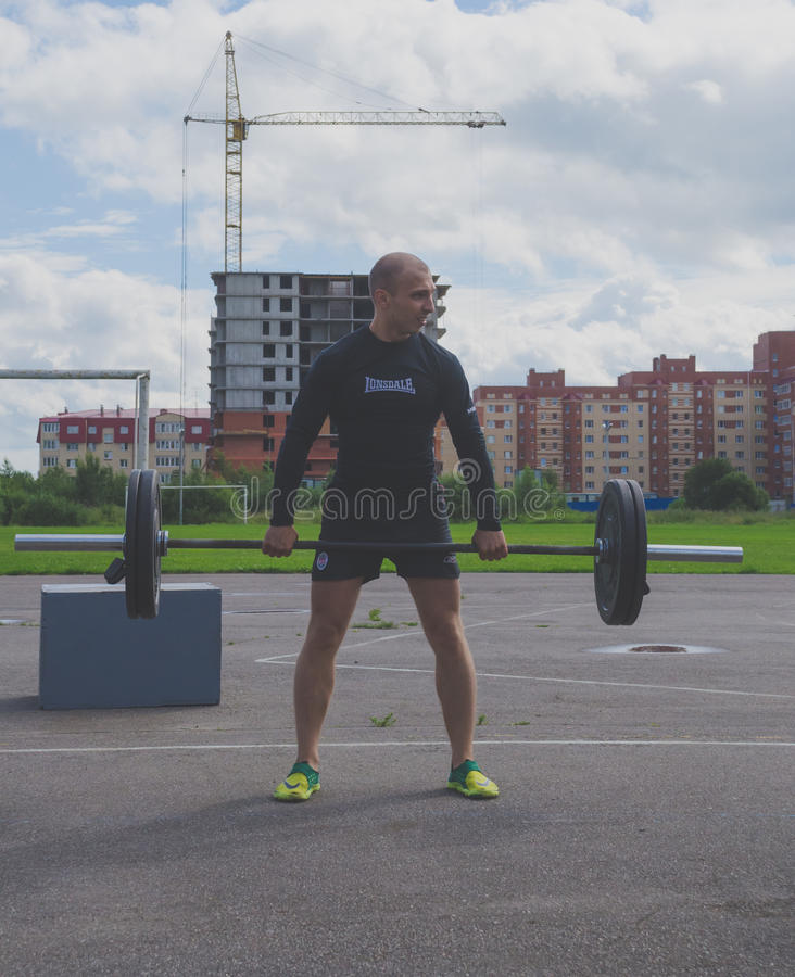 Russia Nikolskoe July 21016 competition in crossfit, the man in black takes post royalty free stock photos