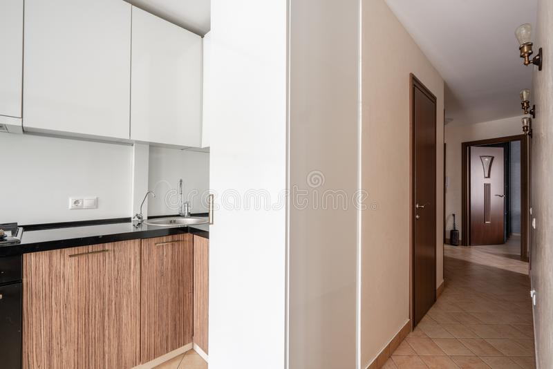 Russia, Nizhny Novgorod - January 10, 2018: Private apartment. Interior design. Small modern kitchen in white and wenge stock photo
