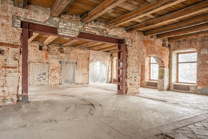 Russia, Nizhny Novgorod - March 20, 2019: Office. Loft studio Interior in old house. Big windows, brick red wall. House royalty free stock image