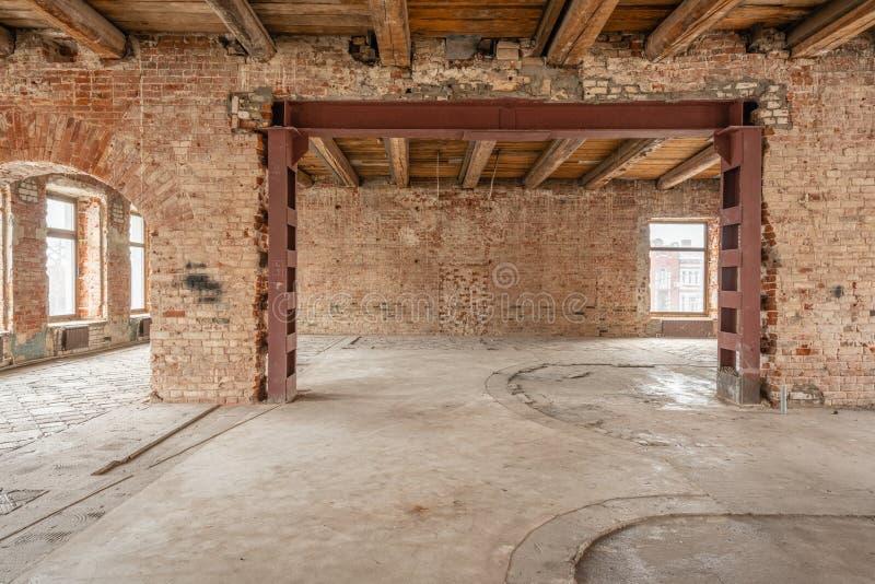 Russia, Nizhny Novgorod - March 20, 2019: Office. Loft studio Interior in old house. Big windows, brick red wall. House royalty free stock photography
