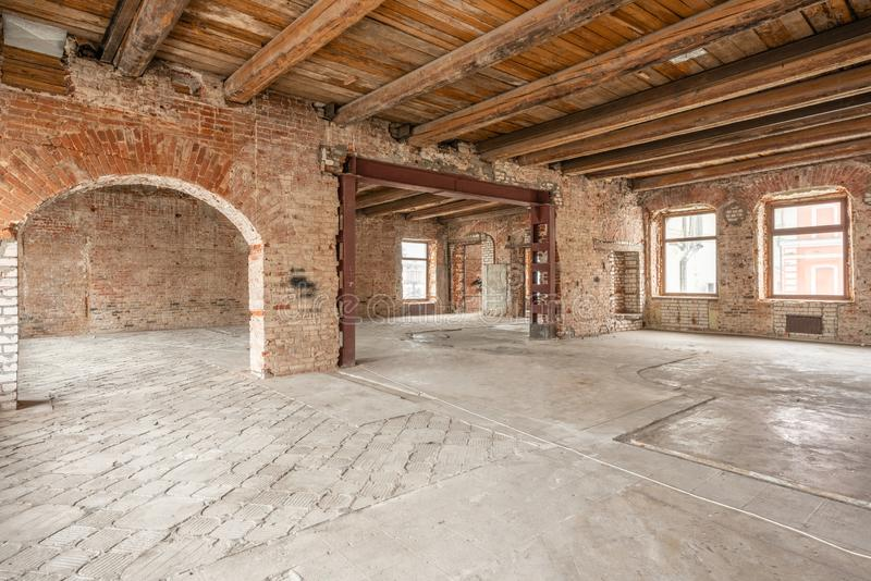 Russia, Nizhny Novgorod - March 20, 2019: Office. Loft studio Interior in old house. Big windows, brick red wall. House royalty free stock images