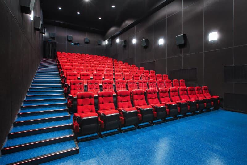 Russia, Nizhny Novgorod - may 23, 2014: Mir Cinema. Empty red cinema hall seats, comfortable and soft chairs royalty free stock photo