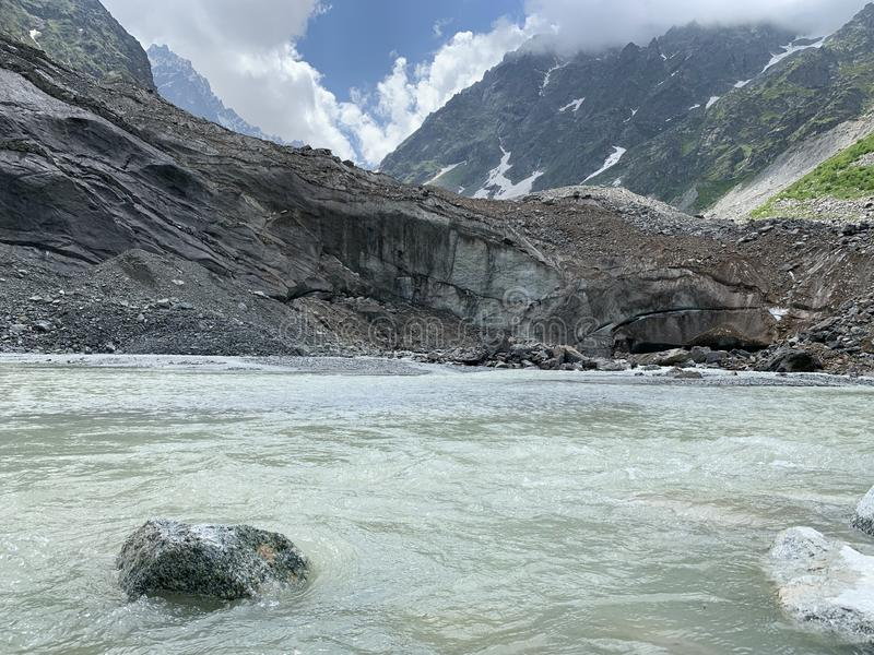 Russia, North Ossetia - Alania. Tsey glacier in summer oin cloudy day.  royalty free stock image