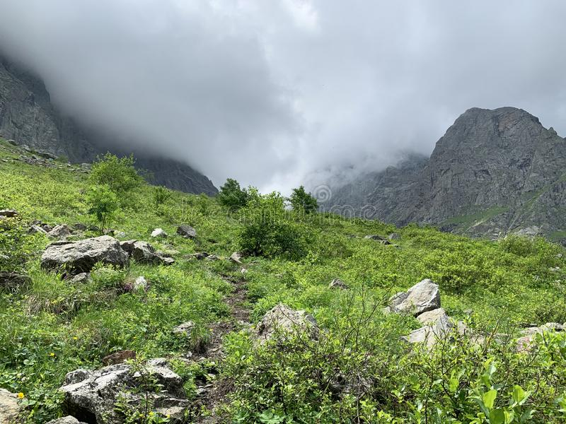 Russia, North Ossetia. Clouds loom over the valley  Midagrabin in the summer.  stock images
