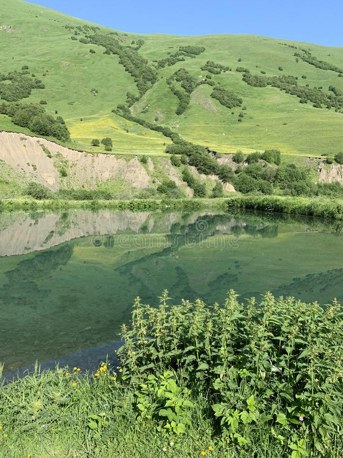 Russia, North Ossetia. Midagrabin Midagrabinskoe lake in the mountains in summer morning.  royalty free stock image