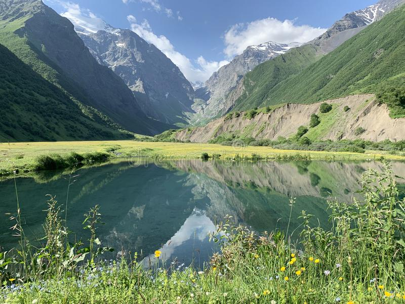 Russia, North Ossetia. Midagrabin Midagrabinskoe lake in the mountains in summer morning.  stock images