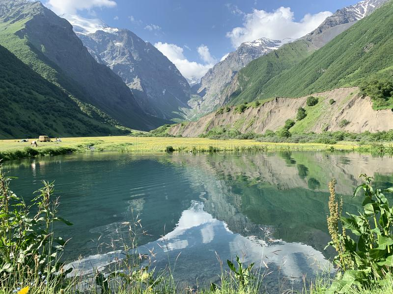 Russia, North Ossetia. Midagrabin Midagrabinskoe lake in the mountains in summer morning.  royalty free stock photo