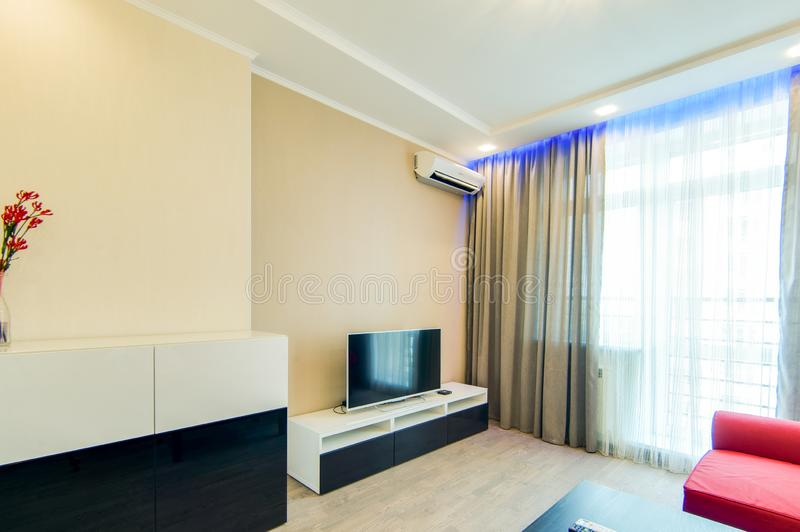 Russia, Novosibirsk - 07 May, 2016: interior room apartment. big white tv. 07 May, 2016: interior room apartment. big white tv royalty free stock image