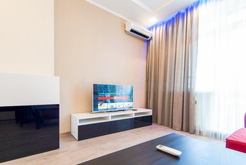 Russia, Novosibirsk - 07 May, 2016: interior room apartment. big white tv. 07 May, 2016: interior room apartment. big white tv stock photos