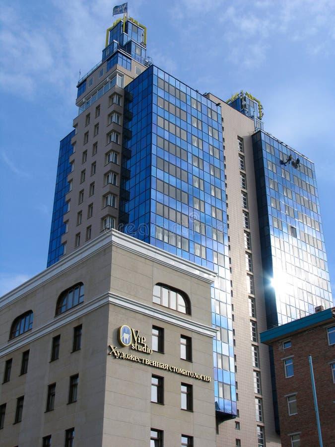 Blue apartment building stock images