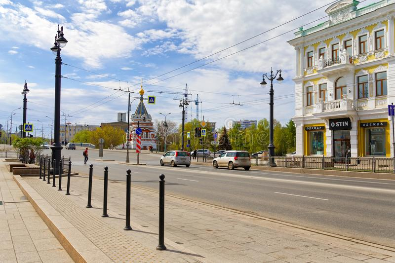 Russia,Omsk.The historic centre of the city is named after Lenin. Editorial.Russia, Siberia, Omsk, May 12 2017. Cars moving on a street named after Lenin stock images