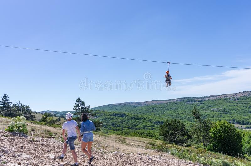 Descent from the mountain to the trolls. Russia, Republic of Crimea. 06.13.2018. Descent from the top of Ai-Petri to the plateau on the trolls. Extreme royalty free stock photo