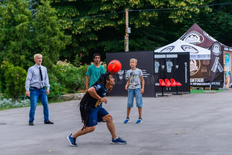 Russia, Rostov on Don, June 25, 2018: Group of happy international young mens play with ball in park. royalty free stock images