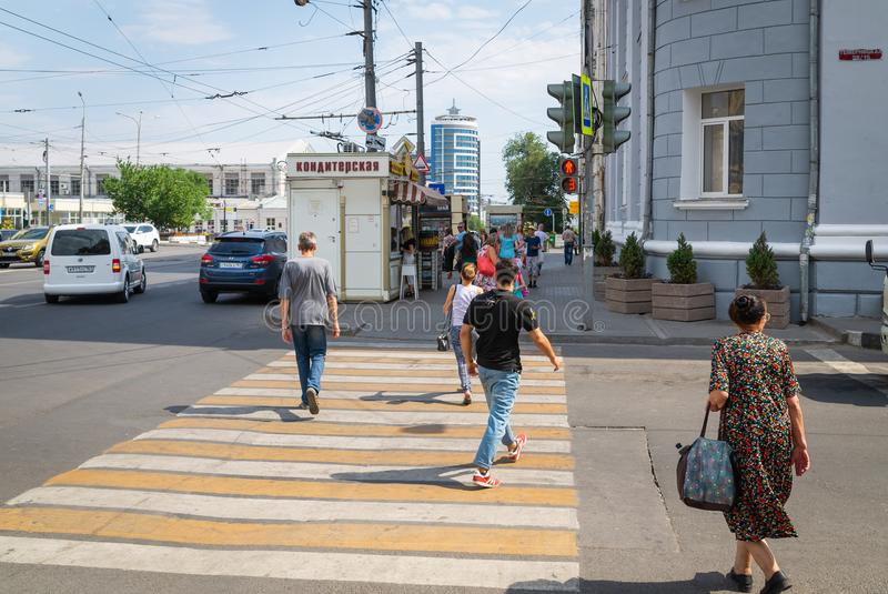 Russia, Rostov on Don, June 28, 2018: People cross the road to a red traffic light. Violation of traffic rules. Danger to life. stock photo