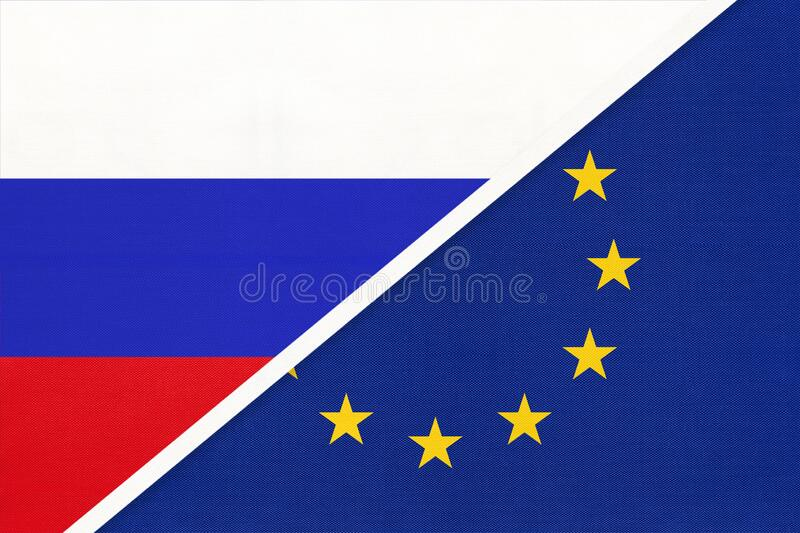 Russia or Russian Federation vs European Union or EU national flag from textile. Schengen zone royalty free stock photography
