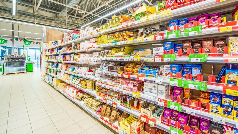 Samara, August, 2018: chocolate and pastry on the supermarket shelf royalty free stock images
