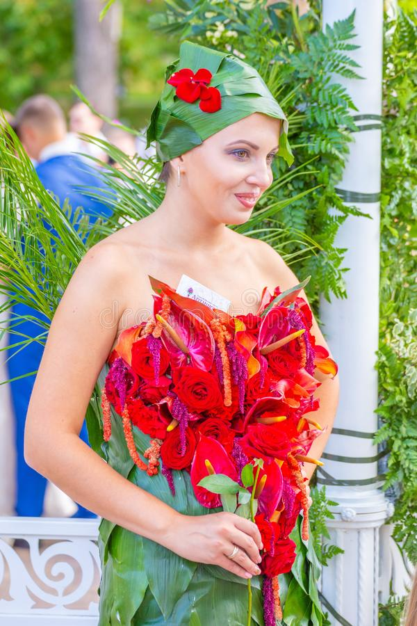 Participant in the competition of dresses at the festival of flowers stock photos