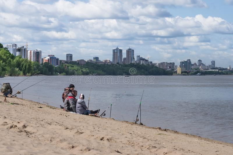2017-05-28 Russia, Samara. Fishermen on the river Bank. Men fisherman fishing. Fishing, spinning from the shore. The concept of stock photography
