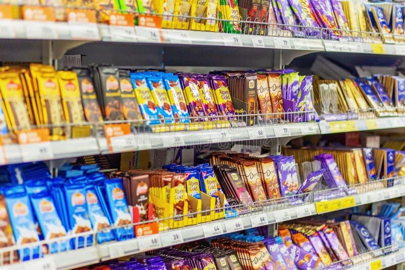 Samara, January 2019: a large selection of chocolate bars on the store shelves stock photos