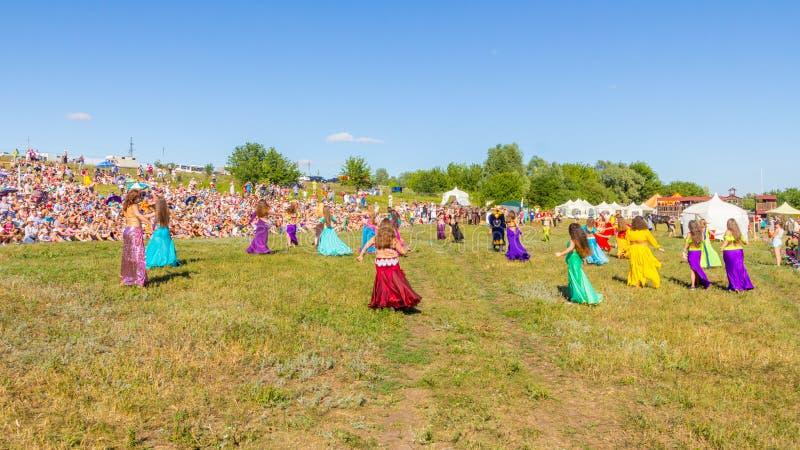 Samara, July, 2018: Dance of oriental beauties before the start of the festival. Russia, Samara, July, 2018: Dance of oriental beauties before the start of the stock photos