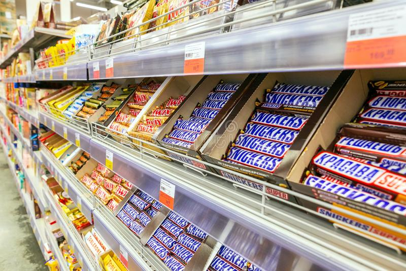 a large selection of chocolate products in the supermarket. royalty free stock images