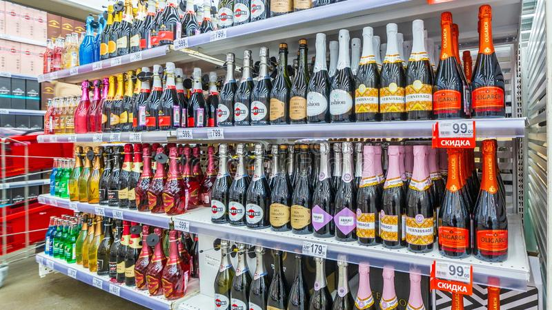 a large selection of sparkling wines in a large supermarket royalty free stock image