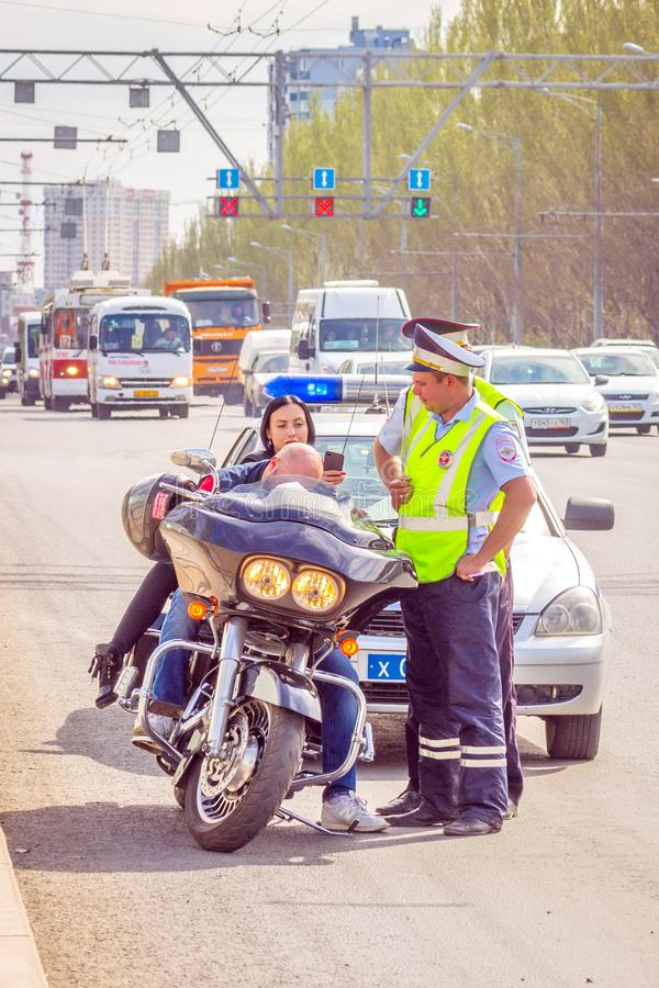 Samara May 2018: Biker was stopped by a traffic policeman for violating the rules of the road stock images