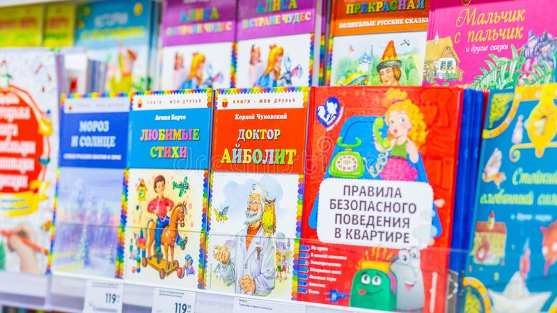 Books on the shelf of a bookstore. Russia, Samara, May 2019: Books on the shelf of a bookstore. Text in Russian: Dr. Aibolit favorite poems Moroh and Sun stock image