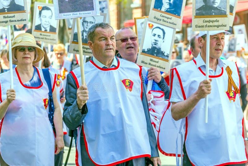 Former elderly Komsomol members in the action  `Immortal Regiment `. Russia, Samara, May 2018: Former elderly Komsomol members in the action `Immortal Regiment` royalty free stock images