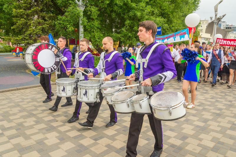 A group of drummers at a festive parade of high school graduates. Russia, Samara, May 2018. A group of drummers at a festive parade of high school graduates royalty free stock images