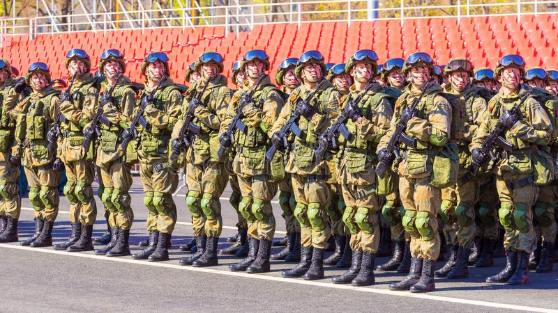 Samara May 2018: Soldiers with automatic weapons. Spring sunny day. royalty free stock images