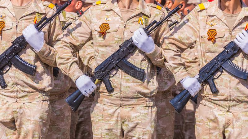 Samara May 2018: Soldiers with automatic weapons. Spring sunny day. stock images